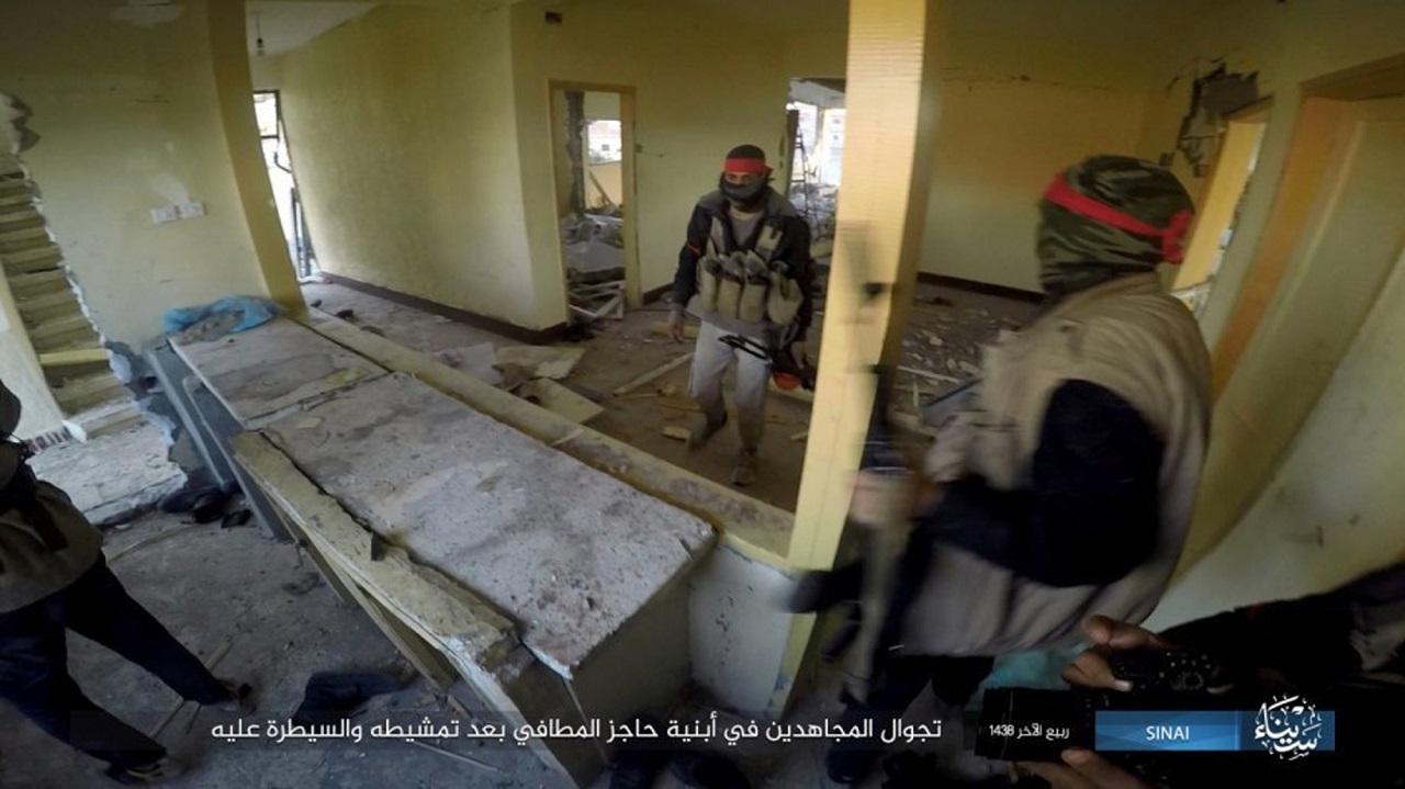 This file photo posted on a file sharing website Wednesday, Jan. 11, 2017, by the Islamic State Group in Sinai, shows a deadly attack by militants on an Egyptian police checkpoint in el-Arish.  Officials say the Friday, July 7, 2017 attack started when a suicide car bomber rammed his vehicle into the checkpoint in southern Rafah village of el-Barth.