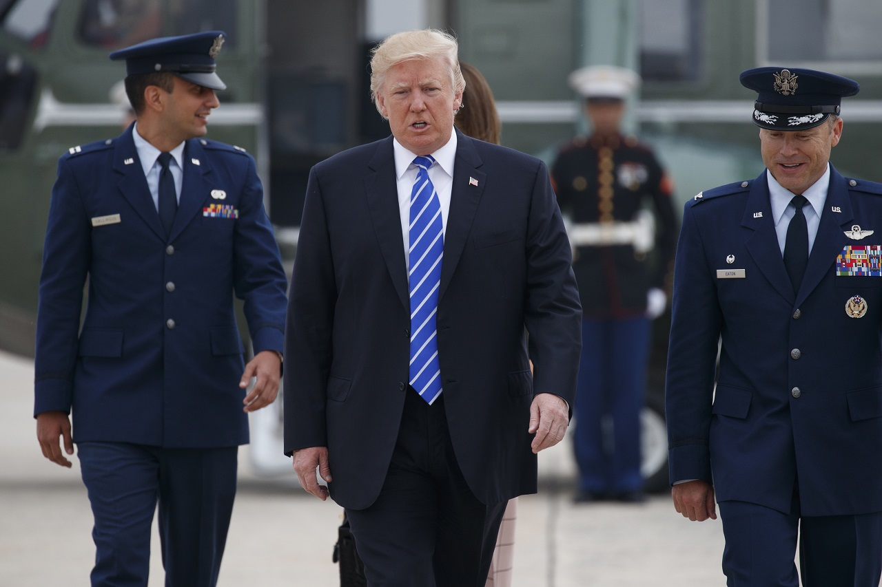 President Donald Trump walks to board Air Force One for a trip to Poland and Germany, Wednesday, July 5, 2017, at Andrews Air Force Base, Md.
