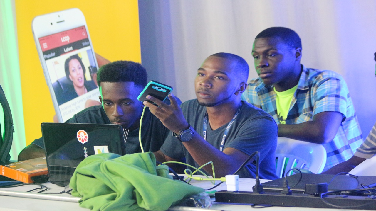Coders Of The Caribbean contestants listen attentively at a briefing ahead of the start of competition on Friday. (Photo: Marlon Reid)