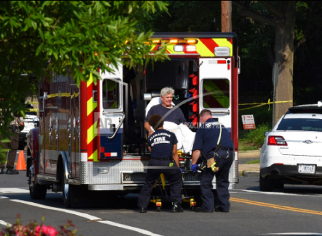 Rep. Roger Williams, R-Texas is placed into an ambulance at the scene of a shooting at a baseball field in Alexandria, Va., Wednesday, June 14, 2017. Members of Congress were practicing for a game when a gunman started shooting.