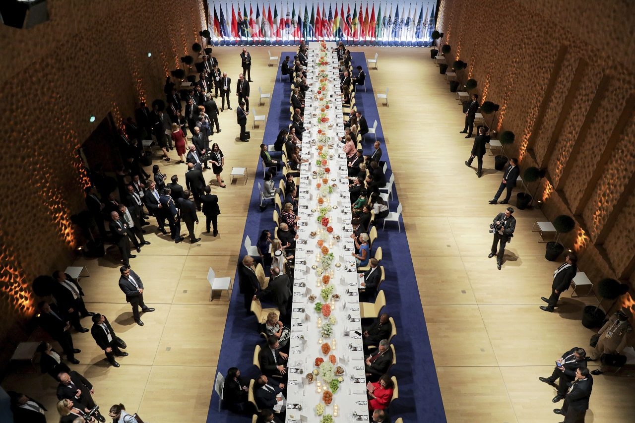 In this July 7, 2017 photo the heads of government of the G-20 states and their partners have dinner after a concert in the Elbphilharmonie concert hall in Hamburg, Germany.