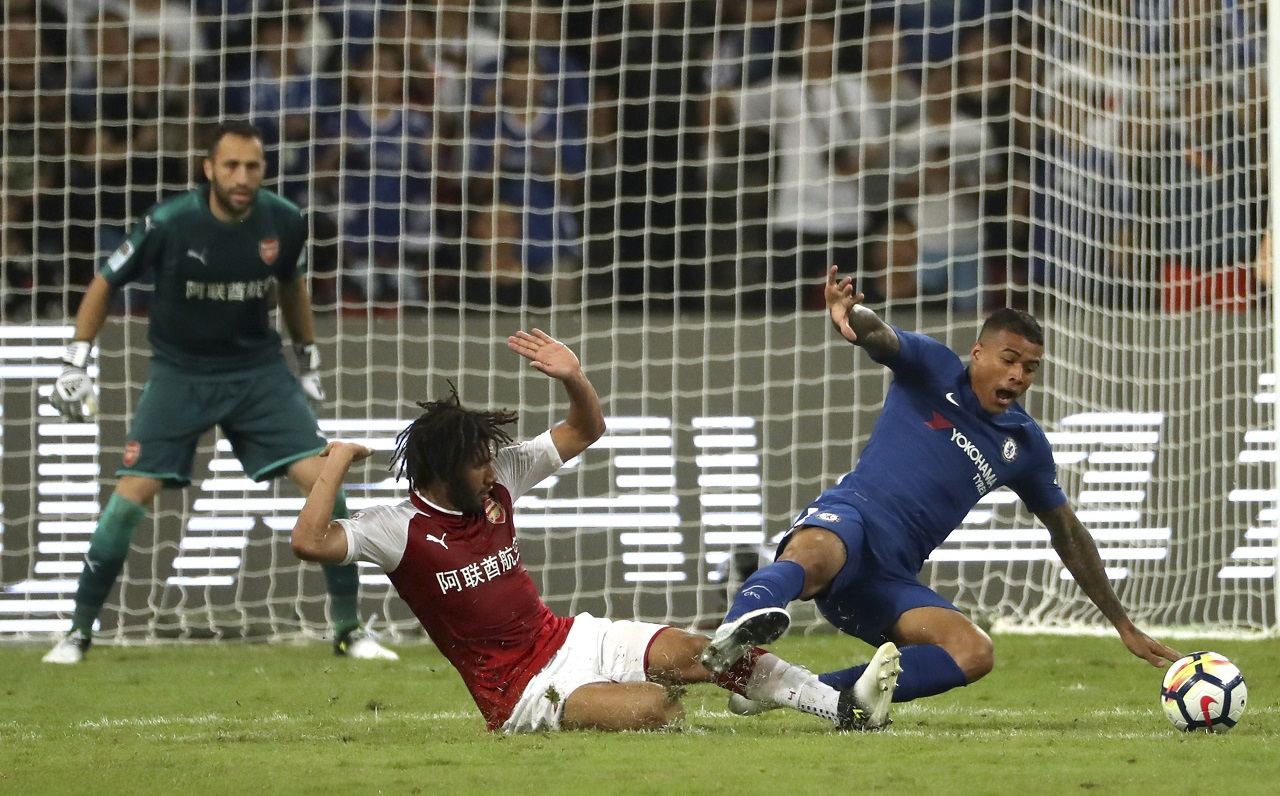 Arsenal's Mohamed El Neny, left, tackles Chelsea's Kenedy during the second half of their friendly soccer match in Beijing, Saturday, July 22, 2017. Chelsea beat Arsenal 3-0.