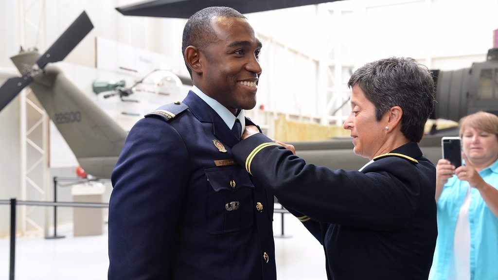 COL Claudia J. Carrizales pins on the US Army Aviator wings on FLT LT Jerrell Alexander