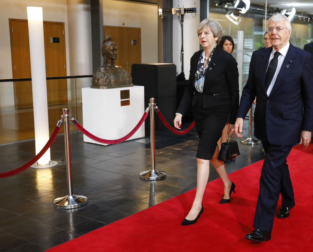 Current British Prime Minister Theresa May and former Prime Minister John Major arrive for a ceremony for former German Chancellor Helmut Kohl at the European Parliament in Strasbourg, eastern France, Saturday July 1, 2017. Current and former leaders from Europe and beyond are gathering in Strasbourg, France to bid farewell to former German Chancellor Helmut Kohl, who died June 16 at 87. (AP Photo/Jean-Francois Badias)