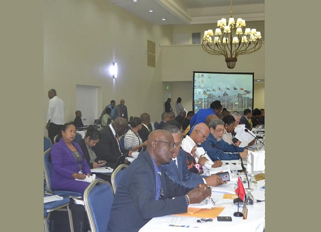 Prime Minister Dr Keith Rowley sits alongside Foreign Affairs Minister Dennis Moses at the first plenary session of a CARICOM meeting in Grenada.