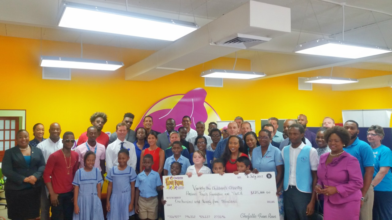 Schools, organisations and businesses involved in the  Chefette Fun Run take a group photo with the cheque.