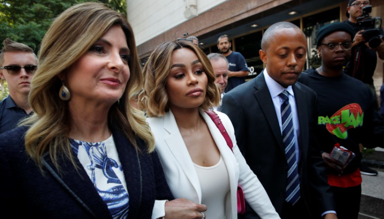 Blac Chyna, center, is flanked by her attorneys, Lisa Bloom, left, and Walter Mosley, as she leaves a courthouse after a hearing on Monday, July 10, 2017, in Los Angeles.