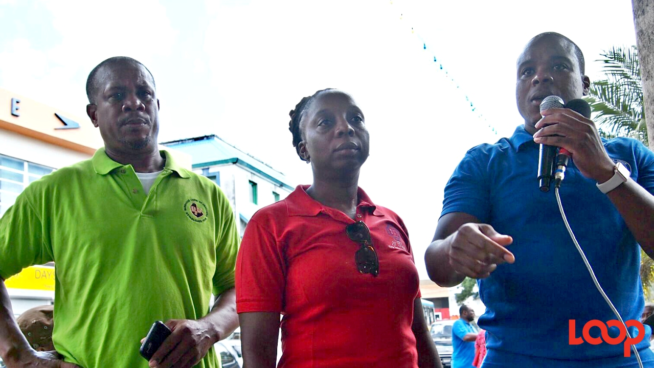 (L-R) BUT President, Pedro Shepherd, BWU General Secretary Toni Moore and NUPW President Akanni McDowall speaking in Independence Square around midday.