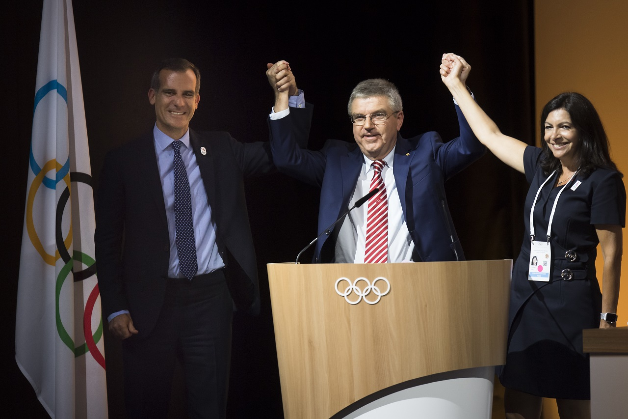 Eric Garcetti, Mayor of Los Angeles, left, International Olympic Committee, IOC, President Thomas Bach, from Germany, center, and Anne Hidalgo, Mayor of Paris, right, pose together during the International Olympic Committee (IOC) Extraordinary Session, at the SwissTech Convention Centre, in Lausanne, Switzerland, Tuesday, July 11, 2017.
