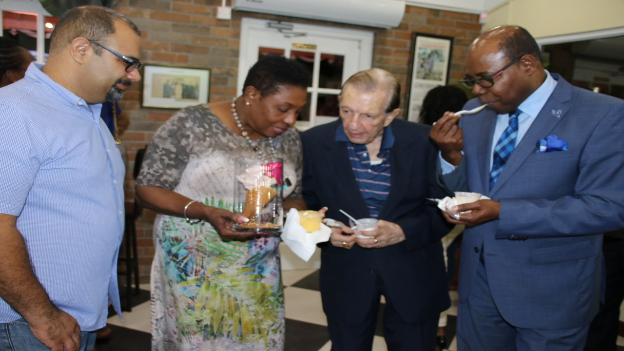 L-R: Christopher Clarke, son of Carol Clarke-Webster, the Managing Director and founder of Scoops Unlimited the manufacturers of Devon House I Scream along with Culture Minister Olivia 'Babsy' Grange, Former PM Edward Seaga, Tourism Minister Edmund Bartlett at the official launch of the expanded Devon House I Scream.
