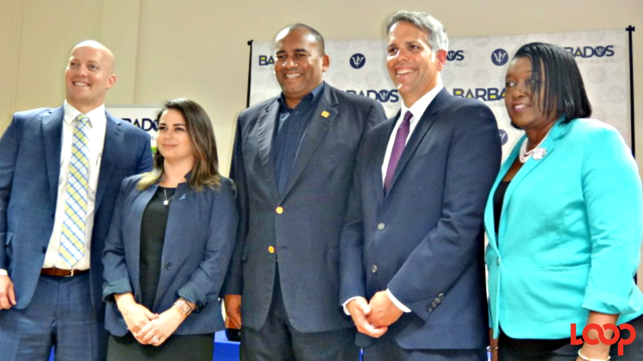 """I think the relationship with JetBlue is truly an important one,"" said Minister Richard Sealy (third from left)."