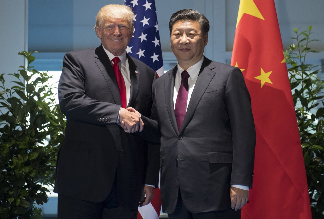 US President Donald Trump and Chinese President Xi Jinping, right, shake hands as they arrive for a meeting on the sidelines of the G-20 Summit in Hamburg, Germany, Saturday, July 8, 2017.