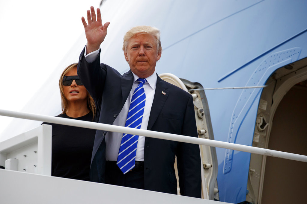 President Donald Trump waves as he boards Air Force One with first lady Melania Trump for a trip to Poland and Germany, Wednesday, July 5, 2017, at Andrews Air Force Base, Md. (AP Photo/Evan Vucci)