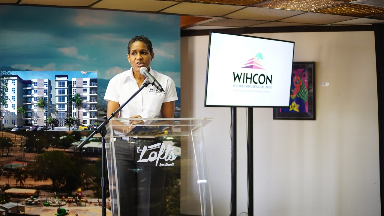 Janelle Brown, WIHCON's Marketing Manager addresses the delegates at the Jamaica 55 Diaspora Conference at the launch of The Lofts.