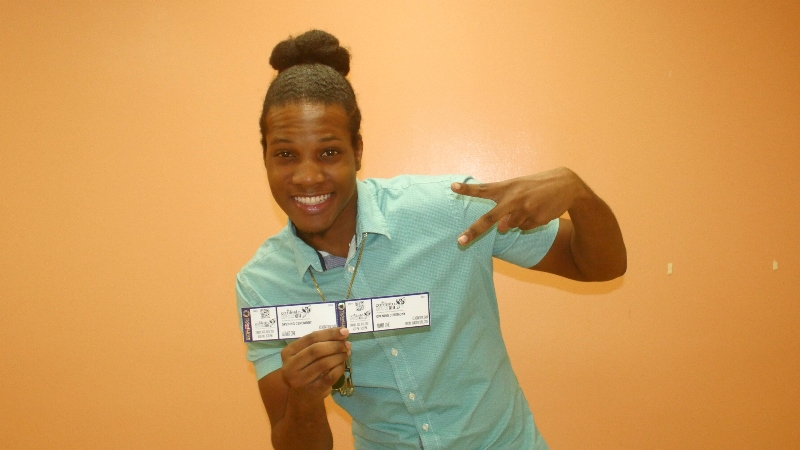 Joaquin showing off the first tickets which he received for the Opening Ceremony for CARIFESTA XIII.