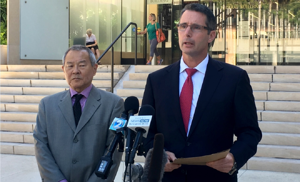 "Paul Delacourt, the FBI special agent in charge of the Hawaii bureau, right, speaks at a news conference as Acting United States Attorney Elliot Enoki, left, listens outside federal court in Honolulu, Monday, July 10, 2017. An active duty soldier based in Hawaii pledged his allegiance to the Islamic State group, helped purchase a drone for it to use against American forces and said he wanted to use his rifle to ""kill a bunch of people,"" according to an FBI affidavit."