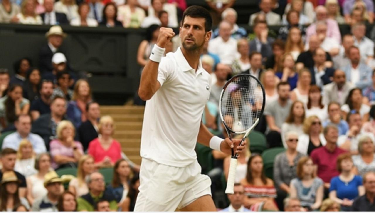 Federer and Murray reach Wimbledon quarterfinals