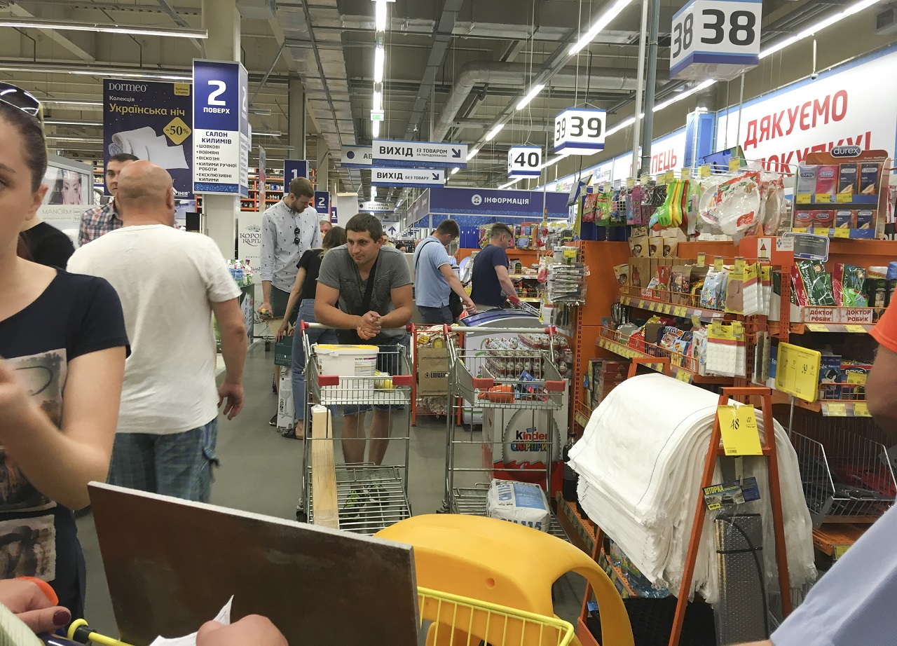 People queue for their turn to pay at a slowly working cash desk in a building supermarket in Kiev, Ukraine, Wednesday, June 28, 2017. The cyberattack ransomware that has paralyzed computers across the world hit Ukraine hardest Tuesday, with victims including top-level government offices, energy companies, banks, cash machines, gas stations, and supermarkets.