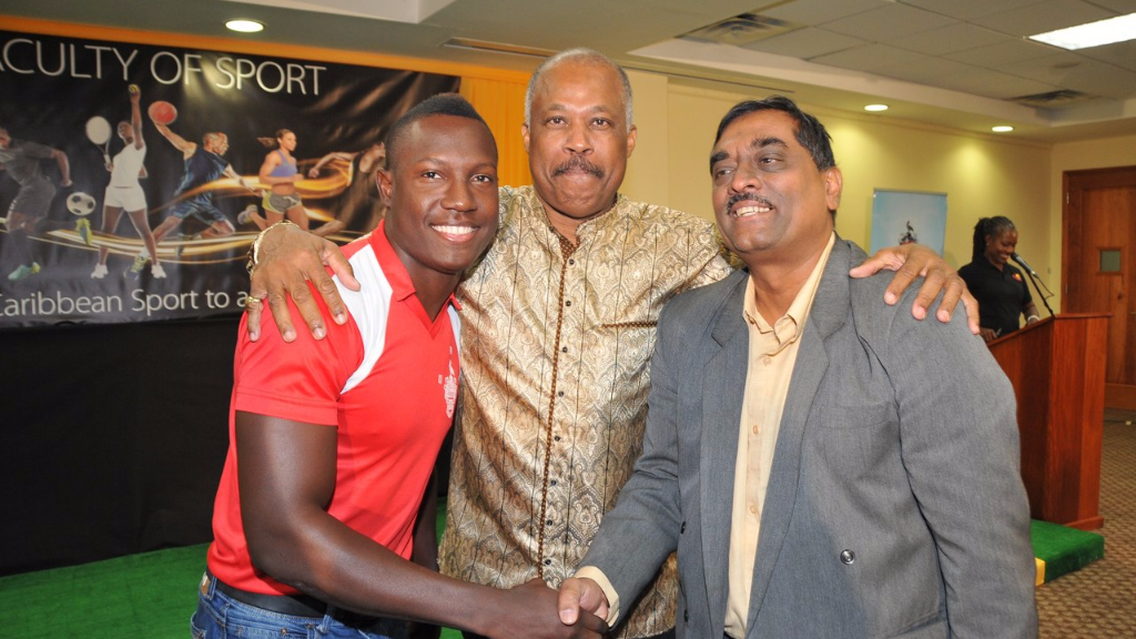L-R: Cricketer, Rovman Powell, UWI Vice-Chancellor, Professor Sir Hilary Beckles and Dean of the Faculty of Sport, Dr Akshai Mansingh share a light moment at the official launch the Faculty on Wednesday.