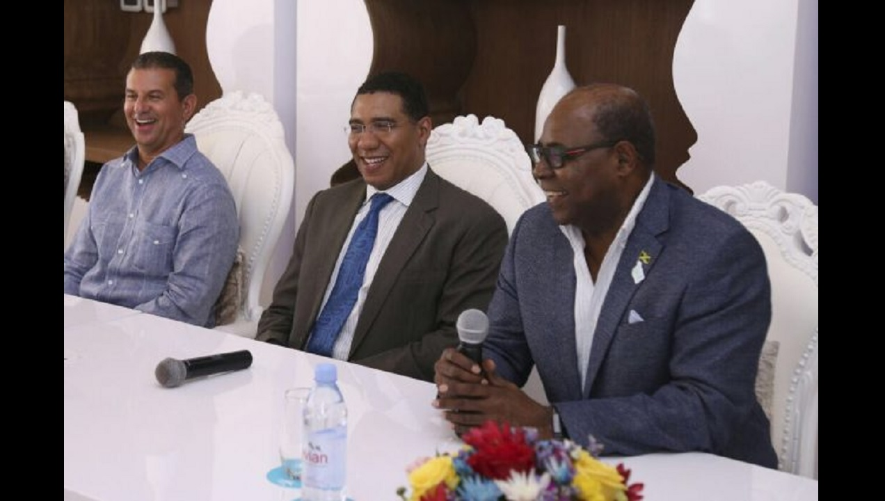 Prime Minister Andrew Holness (centre) shares a laugh with Tourism Minister Edmund Bartlett (right); and Karisma Hotels and Resorts Chairman, Rafael Feliz at the official opening of the Azul Beach Resort Sensatori Jamaica on June 29 in Negril, Westmoreland. (PHOTO: JIS)