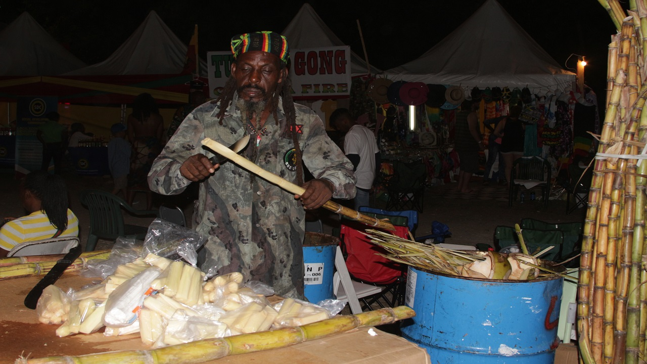 Jonathan Thomas, also known as Israel, a cane and peanut vendor, was satisfied with his returns at Reggae Sumfest. (Photos: Marlon Reid)