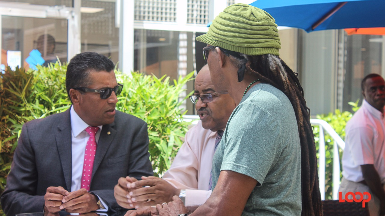 (center) CEO of the NCF Cranston Browne chatting with (left) Managing Director and CEO of Republic Bank Ian De Souza and (right) the producer of Grand Kadooment Adisa 'Aja' Andwele at the launch of the Republic Grand Kadooment.