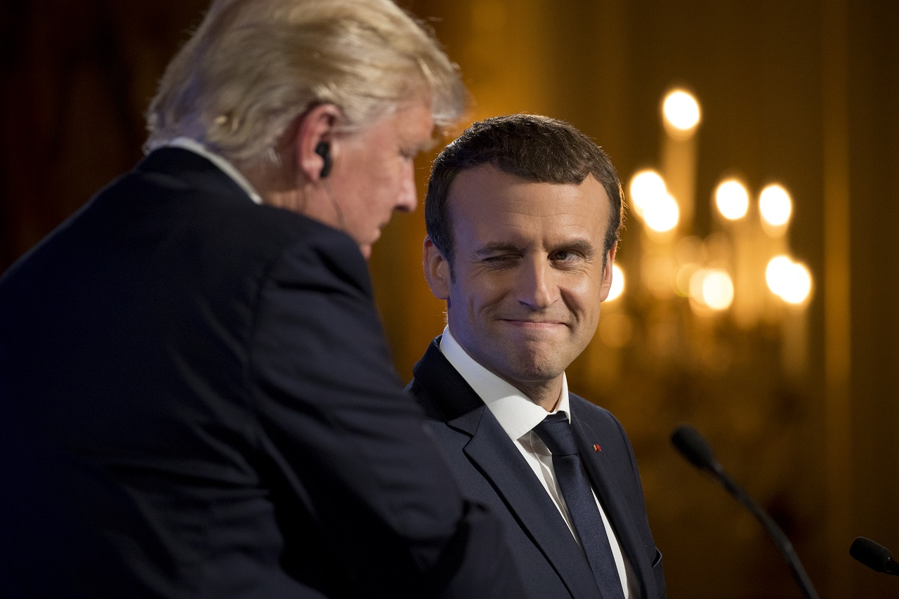 French President Emmanuel Macron winks at President Donald Trump during a joint news conference at the Elysee Palace in Paris, Thursday, July 13, 2017.