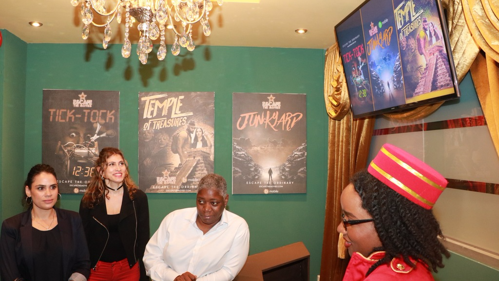 Guests at the launch take a look at the Escape Rooms