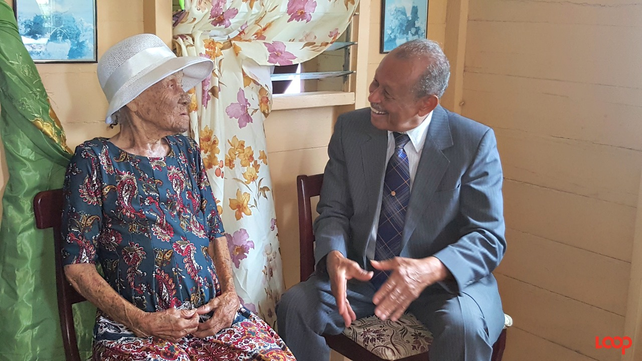(right) Acting Governor General Sir Philip Greaves told (left) Barbados' newest centenarian Una Ifill that he loves to see centenarians from the North.