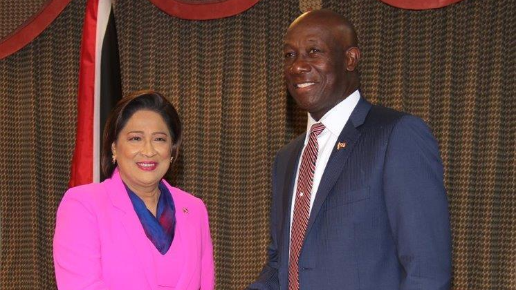 Prime Minister Dr Keith Rowley shakes the hand of Opposition leader Kamla Persad-Bissessar as she arrives for a special meeting with the Prime Minister at the Parliament Building yesterday