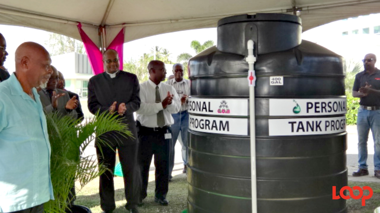 BWA Chairman Dr Atlee Brathwaite at the unveiling of a tank for the COB-supported Personal Tank Programme.