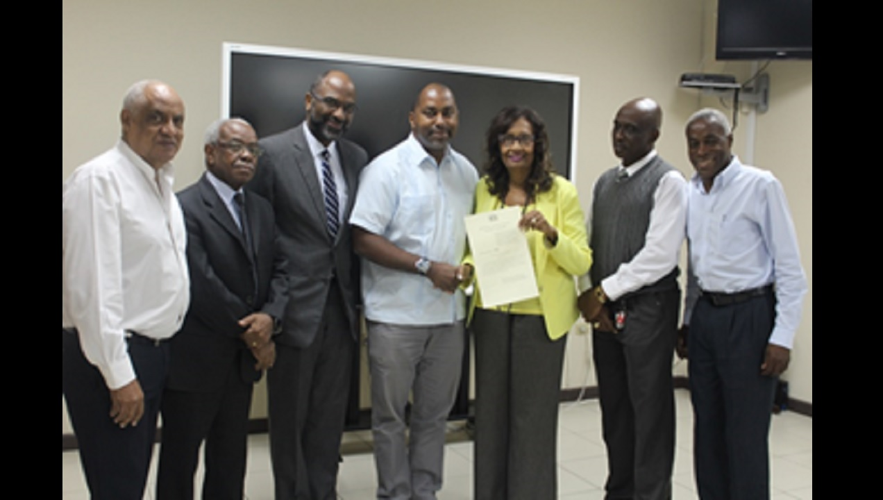 Dorothy Pine-McLarty (3rd right), Chairman of the Electoral Commission of Jamaica (ECJ) welcomes newly appointed ECJ Nominated Commissioner Julian Robinson (centre) on Wednesday, July 12. They are joined by fellow Commissioners (l-r) Dr D K Duncan, Nominated Commissioner (PNP); Justice Karl Harrison and Earl Jarrett, Selected Commissioners; Orrette Fisher, Director of Elections and Professor Alvin Wint, Selected Commissioner.