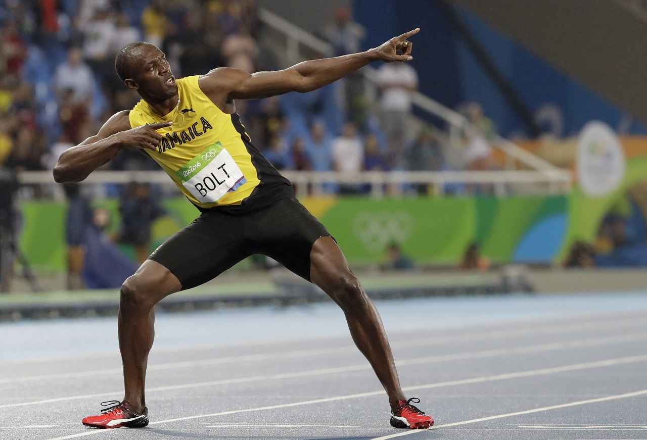 In this Aug. 18, 2016, file photo, Usain Bolt celebrates winning the gold medal in the men's 200m final during the athletics competitions of the 2016 Summer Olympics at the Olympic stadium in Rio de Janeiro, Brazil. Bolt is the only sprinter to capture the 100 and 200 titles at three consecutive Olympics.