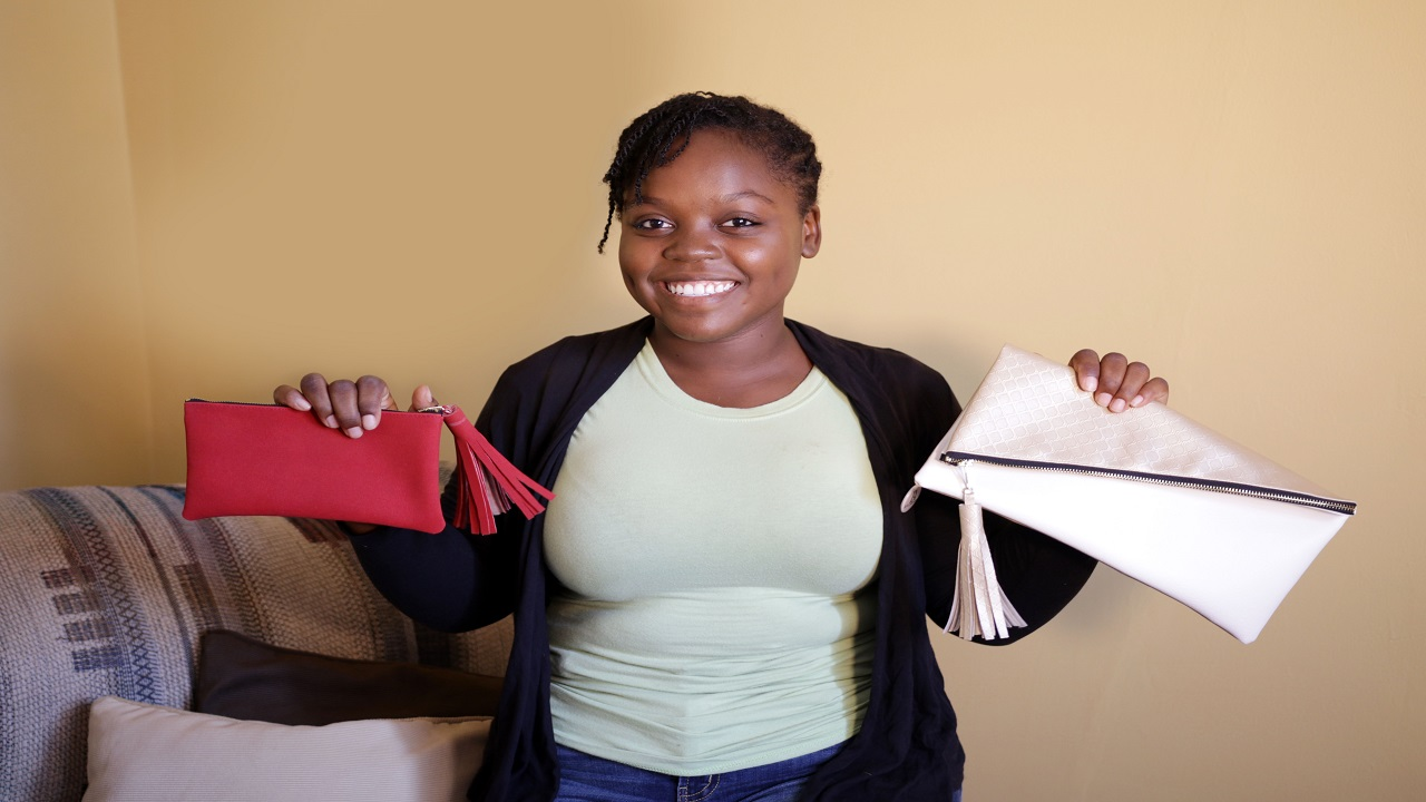 Immaculate Conception High student Damoi Escoffery is running her bag business.