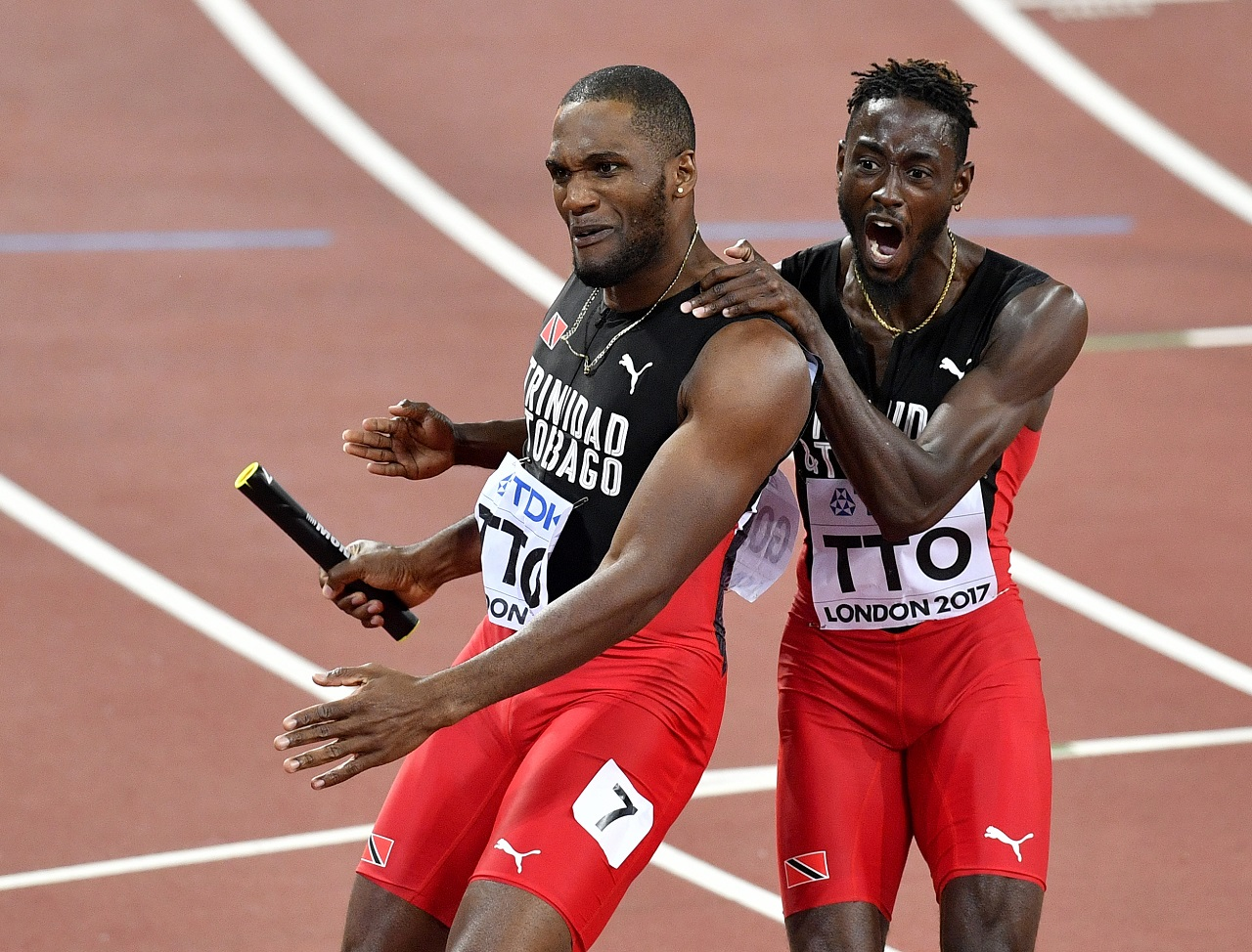 Trinidad and Tabago's Lalonde Gordon celebrates with teammate Jeremy Richards after they won the gold medal in the Men's 4x400 meters relay final at the World Athletics Championships in London Sunday, Aug. 13, 2017.