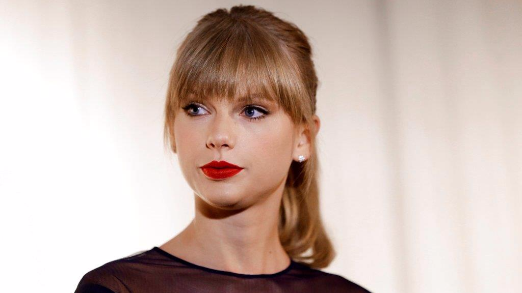 In this Oct. 12, 2013 file photo, Taylor Swift appears at the Country Music Hall of Fame and Museum in Nashville, Tenn. David Mueller, a former radio host, claims in a lawsuit that he lost his job because Swift falsely accused him of groping her. Swift has countersued, alleging she's the victim of sexual assault. Mueller is seeking up to $3 million in damages at the trial that begins Monday, Aug. 7, 2017, in federal court in Denver. Both sides say no settlement is in the works.