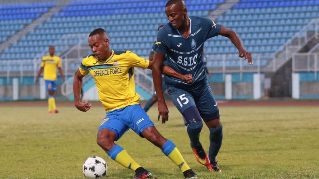Defence Force and Trinidad and Tobago defender Curtis Gonzales, left, holds off Police FC double-scorer Jameel Perry in a 3-1 Pro League win for the Lawmen on Jan. 28, 2017. (TT Pro League)