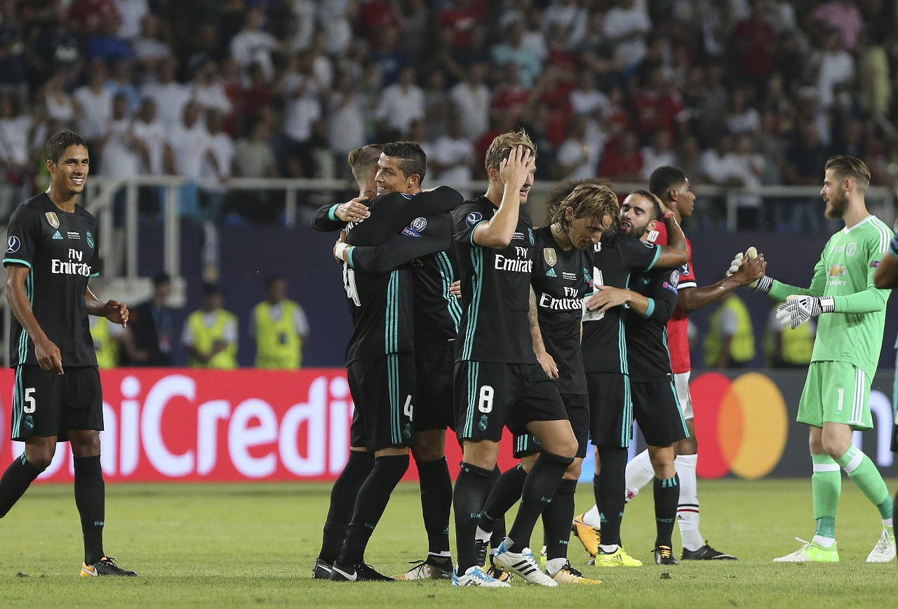 Real Madrid's Cristiano Ronaldo, centre celebrates with teammates their win against Manchester United during the UEFA Super Cup final at Philip II Arena in Skopje, Tuesday, Aug. 8, 2017.