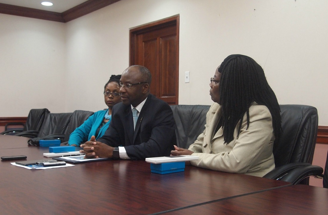 Minister of Culture, Stephen Lashley flanked by Festival Coordinator, Andrea Wells (right) and Permanent Secretary in the Ministry of Culture, Ruth Blackman (left).