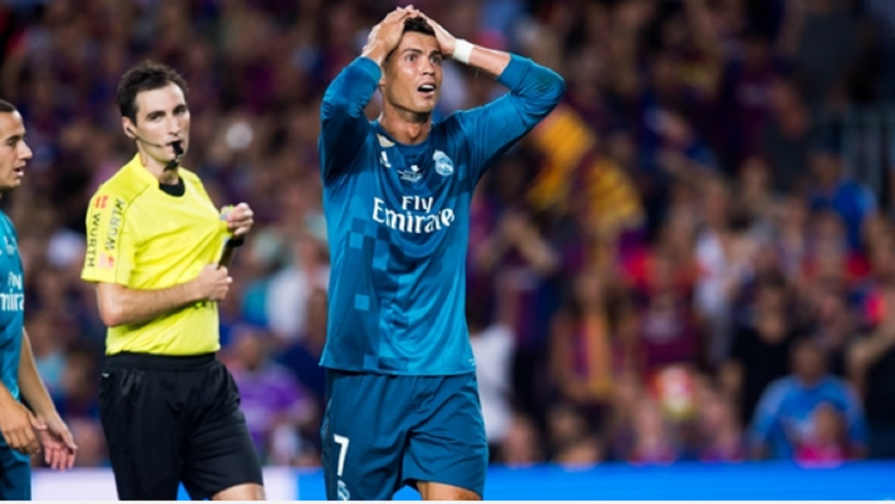 A dismayed Cristiano Ronaldo after being sent off against Barcelona.