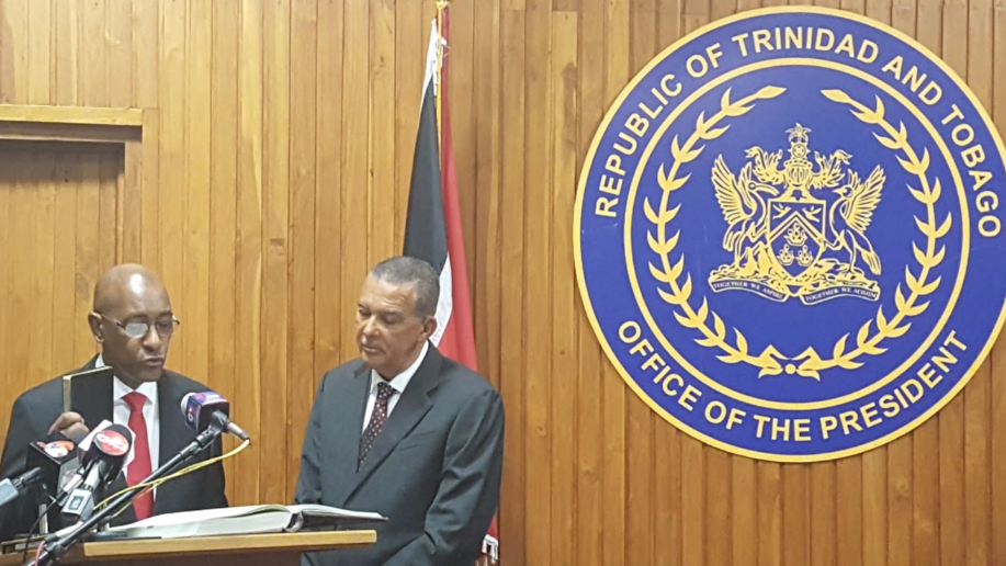 Robert Le Hunte (left) being sworn in as Public Utilities Minister alongside President Anthony Carmona (right).