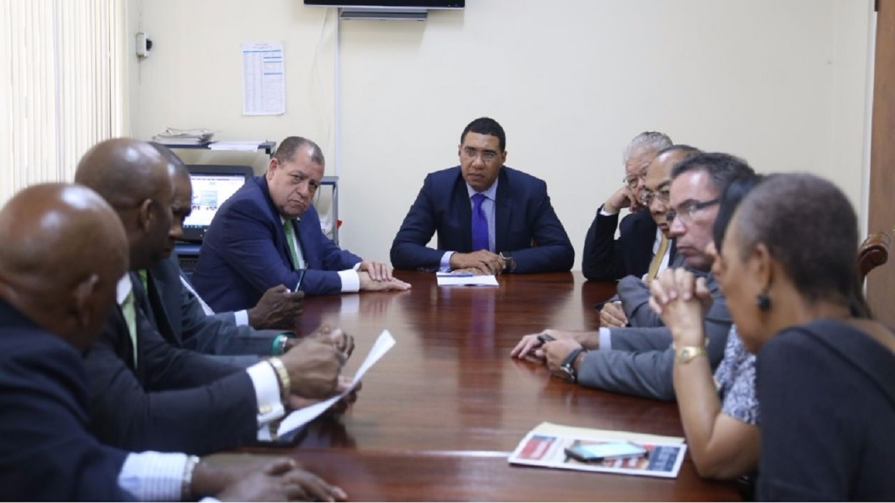 Prime Minister Andrew Holness (centre) with Cabinet members at a meeting recently.