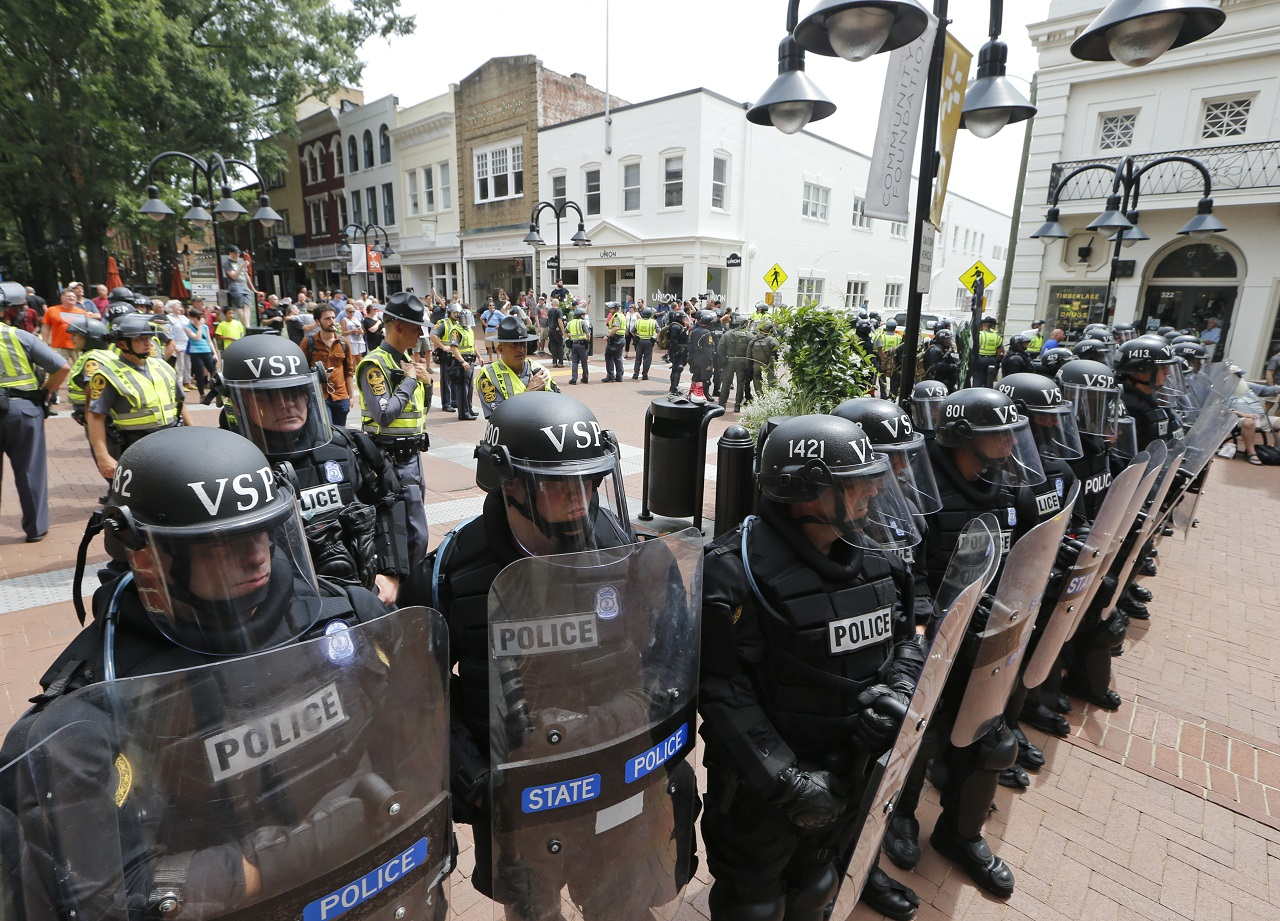Virginia State Police cordon off an area around the site where a car ran into a group of protesters after a white nationalist rally in Charlottesville, Va., Saturday, Aug. 12, 2017.