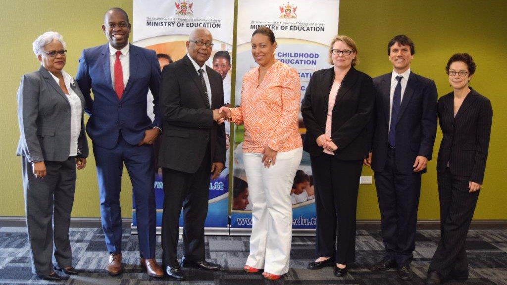 Education Minister Anthony Garcia shakes hands with IDB's Chief of Operations for Trinidad and Tobago, Carina Cockburn following Friday's meeting