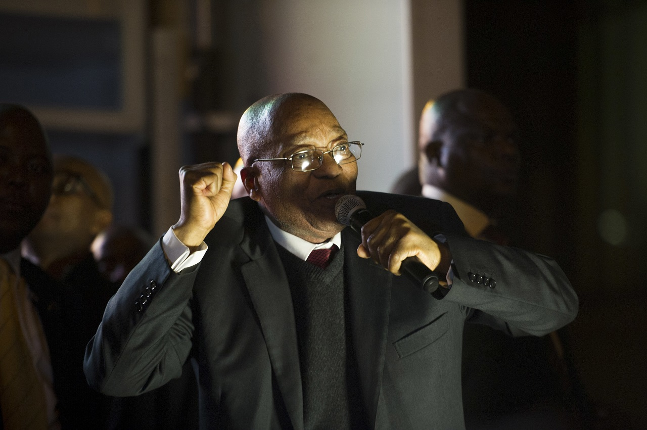 South African President, Jacob Zuma, jubilates after surviving a no-confidence vote by MP's in parliament in Cape Town South Africa, Tuesday Aug. 8, 2017.