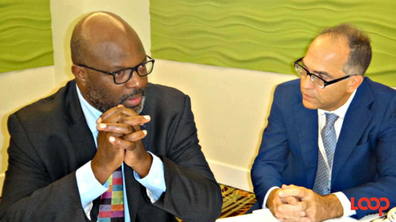 Attorney General of Barbados, Adriel Brathwaite (left), and UN Resident Coordinator and UNDP Resident Representative, Stephen O'Malley.