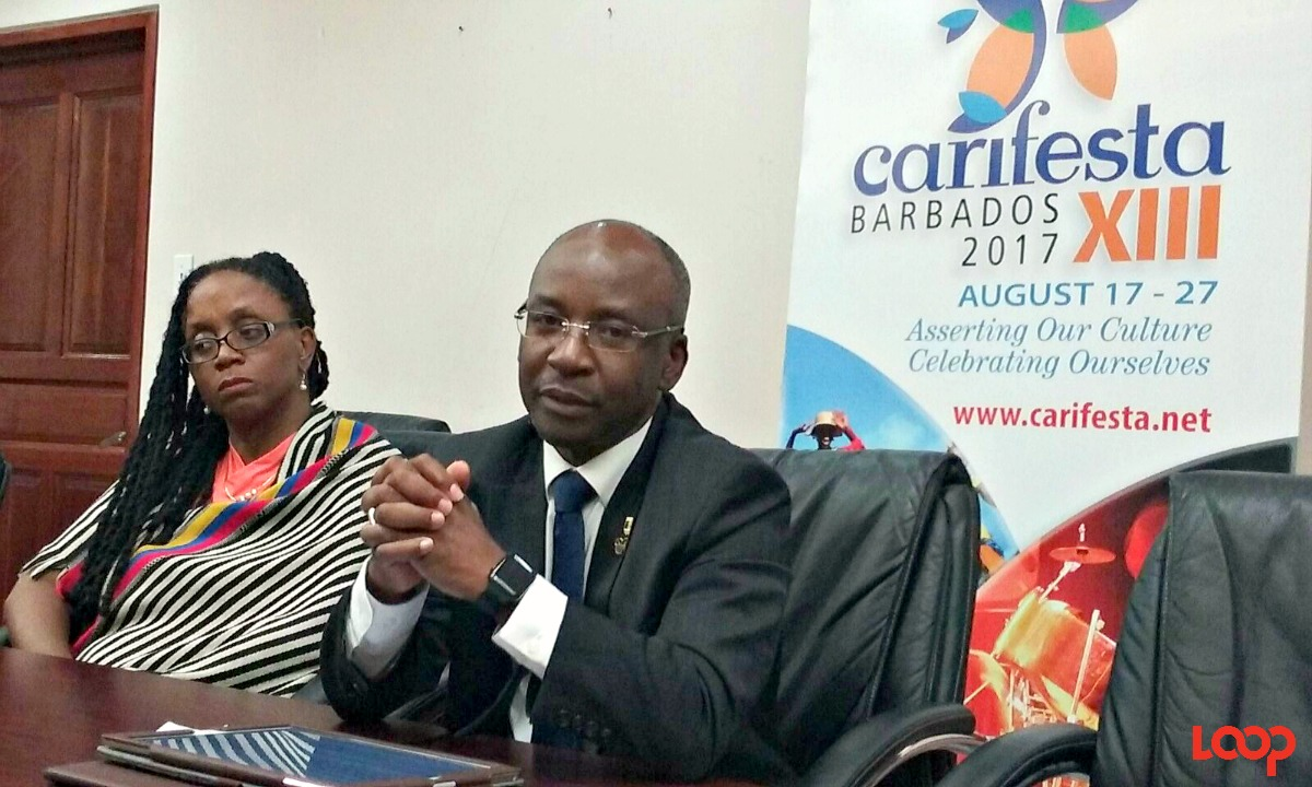 (L-R) Chief Cultural Officer at the NCF and CAARIFESTA XIII Festival Director, Andrea Wells and Culture Minister Stephen Lashley address the media.