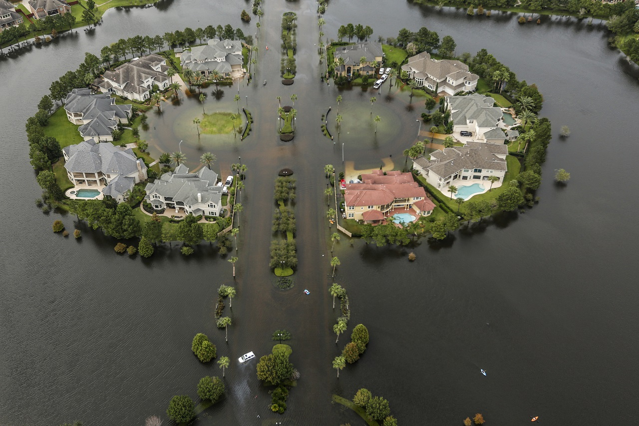 Floodwaters fill the road running through the Lakes On Eldridge North subdivision in the aftermath of Tropical Storm Harvey on Wednesday, Aug. 30, 2017, in Houston.