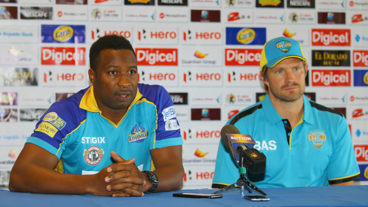 In this handout image provided by CPL T20, Captain of Barbados Tridents Kieron Pollard makes a point to the media as Shane Watson captain of the Saint Lucia Stars listens during the pre-match press conference ahead of match 27, Barbados Tridents vs Saint Lucia Stars, held at the Hilton Hotel on August 30, 2017 in Bridgetown, Barbados. (Photo by Ashley Allen - CPL T20 via Getty Images)