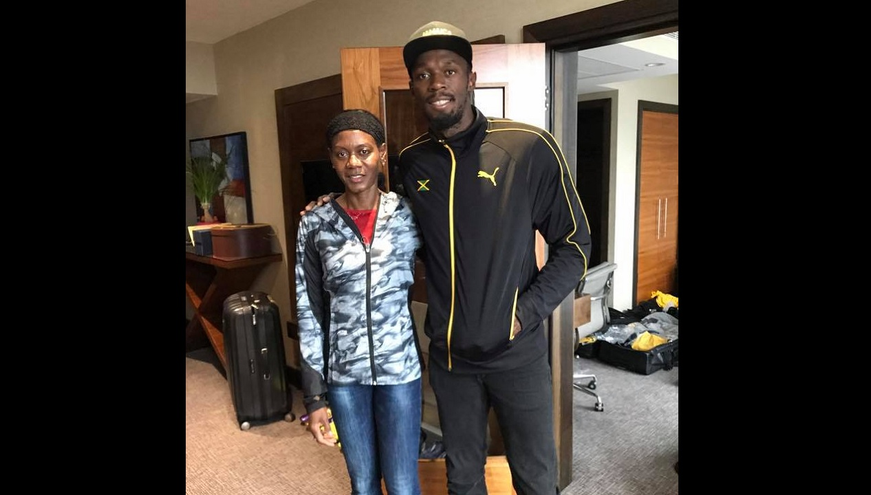 Merlene Ottey with Usain Bolt in London.